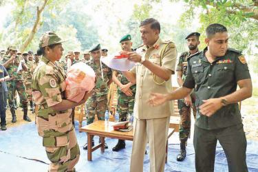 CSD Director General Maj. Gen. Nirmal Koswatte distributes essential items to CSD flood victims.