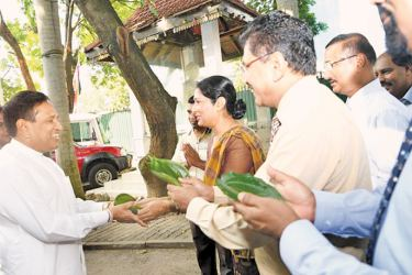 Health Minister Dr. Rajitha Senaratne being welcomed with betel sheaves.