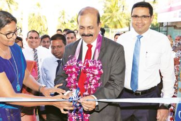 Commercial Bank Deputy Chairman Preethi Jayawardena opening the branch in the presence of Sanath Manatunge Chief Operating Officer and members of management of the bank