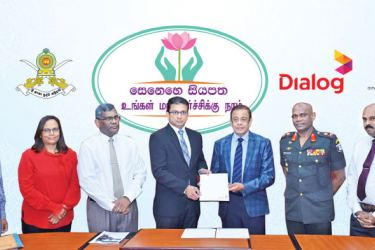 (L-R) S Amalanadan, Additional Secretary, Development, Ministry of Public Administration & Disaster Management, Amali Nanayakkara, Group Chief Marketing Officer, Dialog Axiata PLC,  J. J. Ratnasiri, Secretary, Ministry of Public Administration & Disaster Management, Supun Weerasinghe, Group Chief Executive, Dialog Axiata PLC, Hemasiri Fernando, Secretary, Ministry of Defence, Lieutenant General N U M M W Senanayake - Commander of Sri Lanka Army  and W A Kulasooriya – Additional Secretary, Administration, Mi