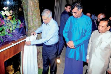 Prime Minister Ranil Wickremesinghe opened the '50K Orchid' Restaurant at the Water's Edge hotel on Tuesday. Finance and Media Minister Mangala Samaraweera, Megapolis and Western Province Development Minister Champika Ranawaka, Health Minister Dr.Rajitha Senaratne and Water's Edge Chairman Chamath de Silva were present. Picture by Chaminda Niroshan