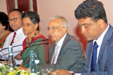 Minister of Development Strategies and International Trade Malik Samarawickrema speaks at the event. EDB Chairperson and Chief Executive Officer Indira Malwatte, Deputy Minister Nalin Bandara and other officials also look on. Picture by- Chaminda Niroshana
