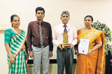 BOI BEPZ team with Award and Certificate.  Amitha Padmini, Assistant Director, H. A. T. Rohitha, Deputy Director, Eng. Athula Jayasinghe, Director - Zone and Renuka Dasanayake, Senior Deputy Director