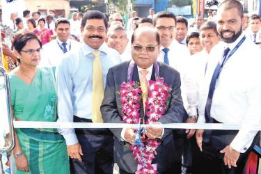 Commercial Bank Chairman Dharma Dheerasinghe opens the new branch in the presence of the Bank's Managing Director S. Renganathan, Chief Operating Officer Sanath Manatunge and Deputy General Manager Personal Banking Sandra Walgama.
