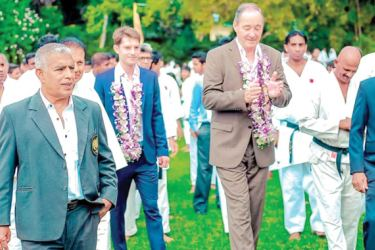 Gunter Mohr and his son Patrick Mohr- are being conducted to the venue by General Secretary of Sri Lanka Karate Do Federation P. Basnayake