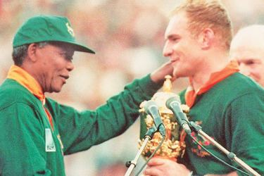 South Africa unites with 1995 Rugby World Cup win: SA captain Francois Pienaar congratulated by President Nelson Mandela.