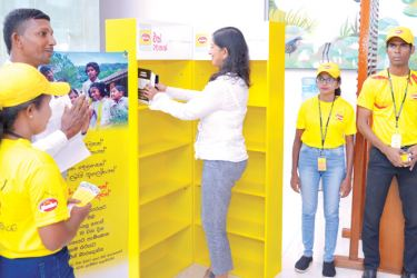 Shea Wickramasingha, Group Managing Director  donating books