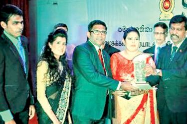 Chairman of Balasooriya Private Hospital,  Priyanthalal Balasooriya receiving the Gold Award