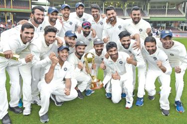 India's team pose with the Border-Gavaskar trophy as they celebrate their series win on the fifth day of the fourth and final cricket Test against Australia at the Sydney Cricket Ground in Sydney on January 7. AFP