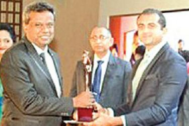 An official from Supremo Tile Factory receiving the award