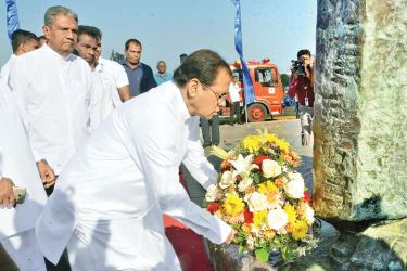 The 120th birth commemoration of former Prime Minister S.W.R.D. Bandaranaike was held yesterday at his statue at the Galle Face Green with the participation of President Maithripala Sirisena. Here, President Sirisena places a floral tribute to the statue at the conclusion of religious rites. Relatives of the Bandaranaike family and Parliamentarians representing the Sri Lanka Freedom Party and the United People's Freedom Alliance were present. Pictures by Wimal  Karunathilaka
