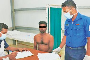 A fisherman undergoing a medical assessment.