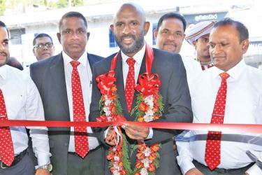 Naleen Edirisinghe Deputy General Manager Branch Credit of Pan Asia Bank is seen opening the branch. Chamika Dilshan Silva Manager Kegalle Branch, Shiyan Perera AGM Branch Credit and Deposit Mobilization, Harsha Kurukulasuriya AGM Operations and Administration and Kithsiri Weerakoon Area Manager looks on.