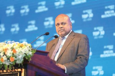 Ajith Gunawardena, Managing Director / CEO of Ceylinco Insurance PLC addressing the gathering at the Business Today Top 30 Awards Ceremony