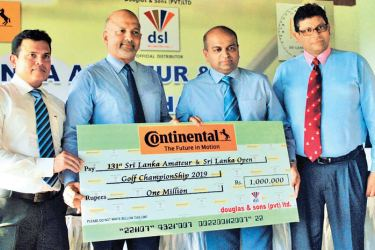The President of Sri Lanka Golf Union Air Chief Marshal Harsha Abeywickrama (second from left) receiving the sponsorship cheque from Executive Director of Douglas and Sons Limited Suren Rajanathan. The others  (from left) General Manager (Tyres) of Douglas and Sons Dammika Jayaweera and Secretary of Sri Lanka Golf Union Nishan Navaratne are also in the picture. Picture by Herbert Perera