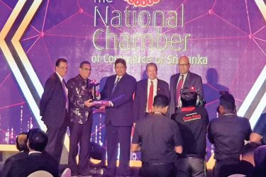 South Asia Textile's Director/COO, Kenneth Wijesuriya, MD/CEO, Prithiv Dorai and CFO, Priyantha Hapuarachchi receives the award from officials