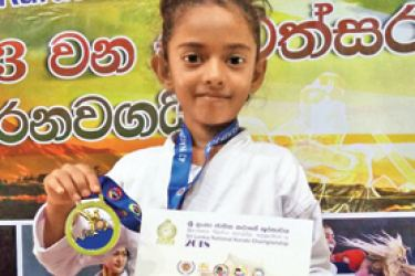 D.Thisara Thathsarani with her gold medal and certificate