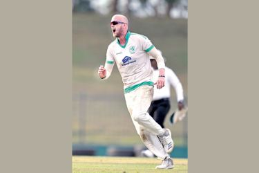 Ireland A's left-arm spinner James Cameron-Dowe celebrates taking five Sri   Lanka A wickets on the third day of the second unofficial Test at Mahinda   Rajapaksa Stadium in Hambantota yesterday.