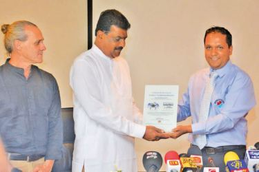 State Minister Dilip Wedaarachchi accepting a token of appreciation from President, SEASL Dilan Fernando. Picture by Ranjith Asanka