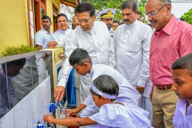 President Maithripala Sirisena inaugurating a drinking water project in Horowpothana recently. Picture by Sudath Silva