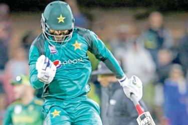 Pakistan's batsman Mohammad Hafeez jumps as he celebrates his team's victory against South Africa during the first One Day International (ODI) at Saint Georges cricket stadium on Saturday. - AFP
