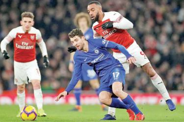 Chelsea's Mateo Kovacic in action with Arsenal's Alexandre Lacazette in their English Premier League match at Emirates Stadium on Saturday.