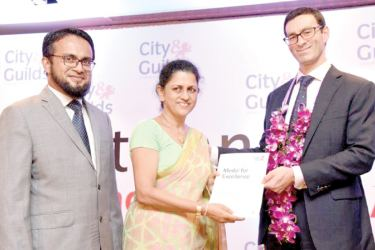Hifaz Ashroff (Head of Key Accounts and Partnerships South Asia of City and Guilds), Kamanie Jayalath (Deputy Chief HR Officer SLT),  Jeremy Dahdi (Executive Director of International of City and Guilds) at the awards ceremony.