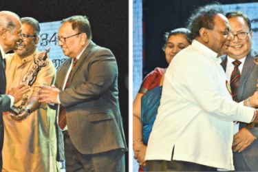 Veteran Photographer G. Hettiarachchi and Veteran announcer, former Ministerial Media Secretary and ANCL Editorial Director Seelaratne Senarath receiving Kalabhooshana awards from Deputy Cultural Affairs Minister A. H. M. Haleem and Northern Province Governor Dr. Suren Raghavan respectively. Picture by Sudath Malaweera