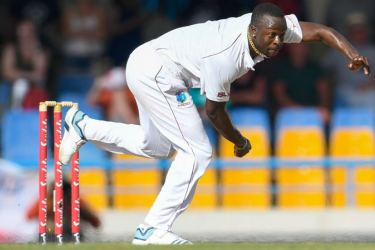 West Indies fast bowler Kemar Roach bowling on the first day of the second cricket Test against England at Vivian Richards Cricket Stadium in Antigua and Barbuda on Thursday. Roach took four wickets and England were dismissed for 187.