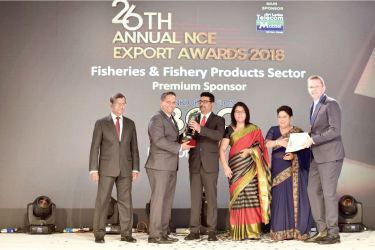 Taprobane Seafood Group (TSG) clinched three awards at the 'National Chamber of Exporters (NCE) Awards 2018' and here founders, Timothy O' Reilly and Dilan Fernando receiving the awards recently at Shangri-La, Colombo