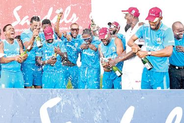 West Indies team celebrate winning the second Test and winning 2-0 lead in series.