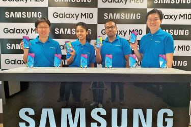 The Samsung team showcasing the Galaxy M series phones Yong - Keun Hwang  Director Mobile, Samsung Sri Lanka, Ruvini Nuwangi Marketing Executive, Samsung Sri Lanka, Shantha Fernando General Manager and Head of Mobile Biz, Hanbae Park Managing Director, Samsung Sri Lanka.