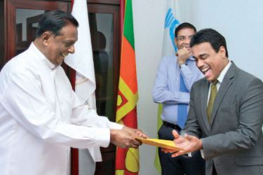 Minister John Amaratunga presenting the letter of appointment to Kishu Gomes. Picture by Dushmantha Mayadunna
