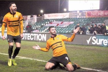 Newport County's Padraig Amond celebrates scoring their second goal in the FA Cup Fourth Round Replay match against Middlesbrough at Newport on Tuesday.