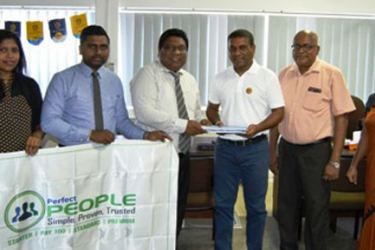 Perera & Sons Bakers (Pvt) Ltd and Perfect Business Solution  Services (Pvt) Ltd officials after signing the agreement