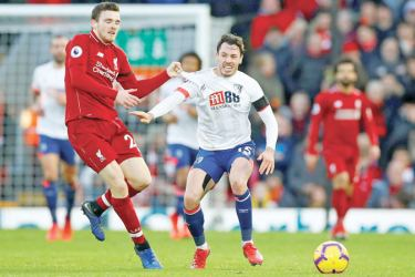 Liverpool's Andrew Robertson in action with Bournemouth's Adam Smith during their Premier League match on Saturday.