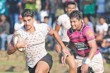 CH and FC's Australian centre Adam Gauder out running Havies winger Sadun Herath and on his way to for a superb try. Picture by Wasitha Patabendige