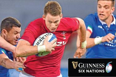 Wales' wing Liam Williams runs with the ball during the Six Nations rugby union tournament match against Italy at the Olympic stadium in Rome on Saturday. - AFP