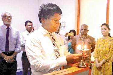 Dr. Chandana Weerasinghe, Medical Director, 'Ayubowan Wellness Medicare Hospital' commissioning the hospital by lighting traditional oil lamp