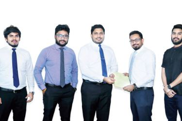 Official of Fairfirst Insurance and PayHere signing the MOU