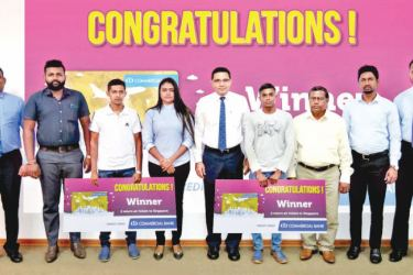 Some of the winners of the air tickets to Singapore with Commercial Bank's Chief Operating Officer Sanath Manatunge, Deputy General Manager Marketing Hasrath Munasinghe and Head of Card Centre Thusitha Suraweera.