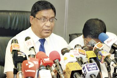 SLC competent authority and Sports Ministry secretary Chulananda Perera addressing the press conference at the Ministry premises yesterday.