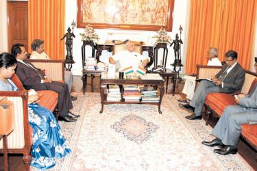 Tamil Nadu Governor Banwarilal Purohit and Sri Lankan High Commissioner to India Austin Fernando during the discussions.