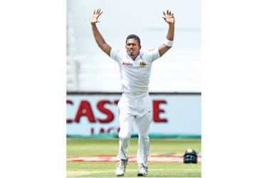 Sri Lanka's Vishwa Fernando appeals and gets the wicket of South Africa's Dean Elgar in the second over during day 1 of the first Test cricket match at the Kingsmead Stadium in Durban on Wednesday. AFP