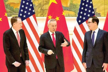 US Trade Representative Robert Lighthizer, Chinese Vice Premier and lead trade negotiator Liu He and US Treasury Secretary Steven Mnuchin chat before the opening session of trade negotiations in Beijing on Feb 14, 2019. Photo: AFP