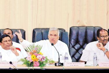 Prime Minister Ranil Wickremesinghe addressing the District Development Committee meeting at the Jaffna District Secretariat yesterday. Picture by Hirantha Gunathilake