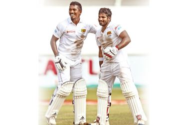 Vishwa Fernando and Kusal Perera savour victory after their world record highest fourth innings 10th-wicket stand of 78 to win a Test.