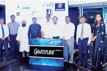 Some of the loyal customers who received 'Gratitude' Loyalty Card with Pradeep Amirthanayagam, Deputy Chairman and Directors of PLC at the 'Gratitude' Loyalty Card launch event.