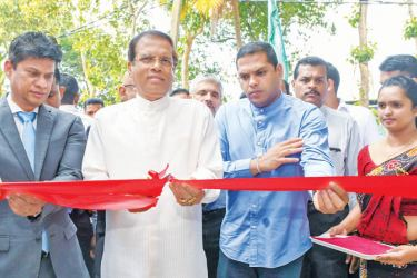 President Maithripala Sirisena cuts the ribbon to open the Sri Lanka Anti-Doping Agency at the Sugathadasa Outdoor Sports Stadium in Colombo yesterday. SLADA Chairman Prof.Arjuna De Silva and Telecommunication, Foreign Employment and Sports Minister Harin Fernando look on. Picture courtesy President's Media Division