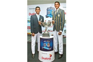 St. Joseph's College skipper Ashain Daniel (on left)and St. Peter's College skipper Ranmith Jayasena with the Rev.Fr. Maurice LeGoc trophy